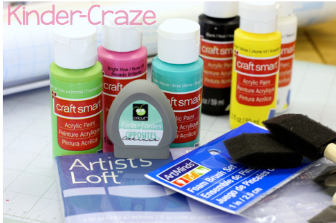 supplies for creating a chalkboard-inspired painted canvas sign