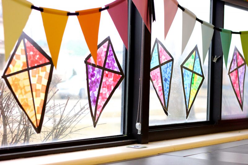 Stained glass kite decorations made from tissue paper for Art classroom decoration ideas