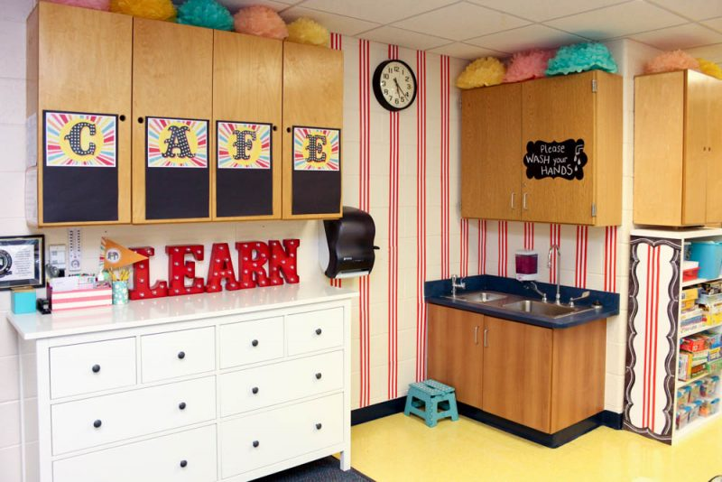 vintage circus theme kindergarten classroom with bright red stripes on the walls and marquee letters
