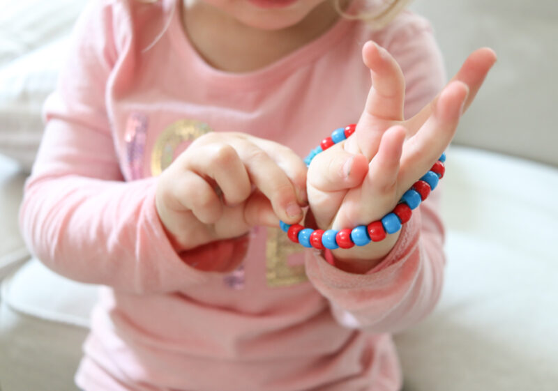 Making pattern bracelets with pipe cleaner and pony beads is a simple and craft to do with your toddler.