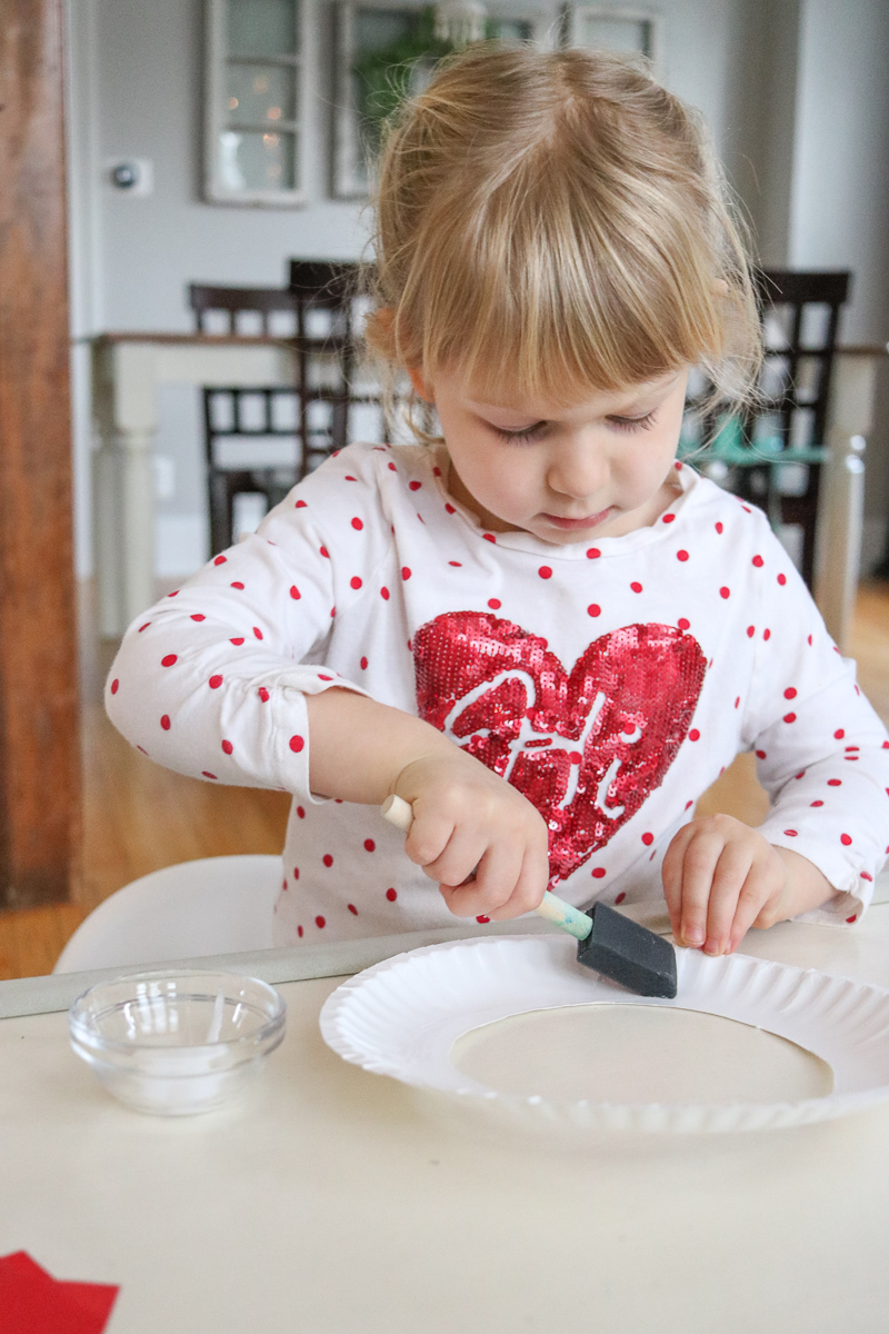 """Here's a fun and easy Christmas craft that's preschool-friendly and great for little hands. All you need is a paper plate, some tissue paper squares and a bottle of glue - ribbon is just a bonus if you're feeling """"extra"""""""