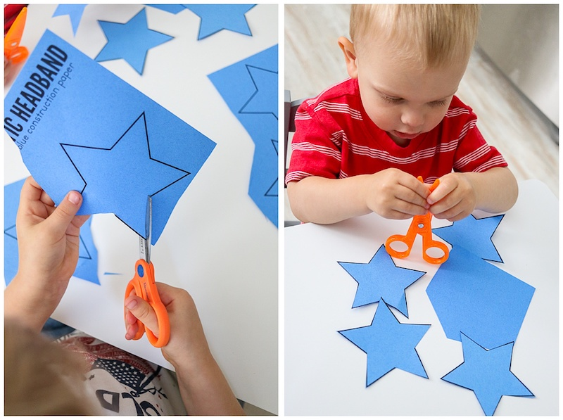 kids cutting out stars to create 4th of July craft