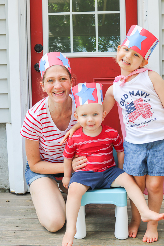 family celebrating 4th of July by wearing patriotic red white and blue hat kid crafts